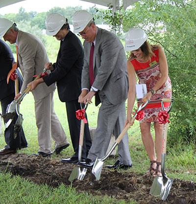 photo of administrators breaking ground for Olathe West
