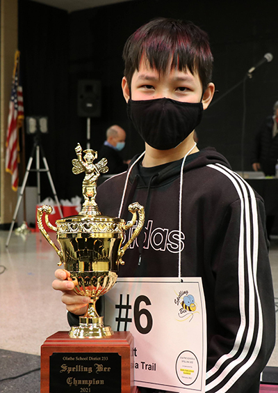 photo of Garrett Li holding his trophy